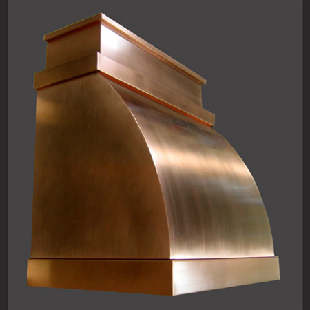 Tiered copper range hood with light antique finish