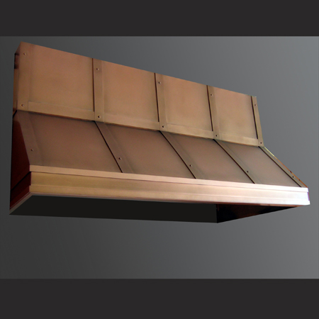 copper range hood features vertical and horizontal strapping details with hand-set rivets. The antique finish has been sealed with a clear lacquer with two coats of wax applied.