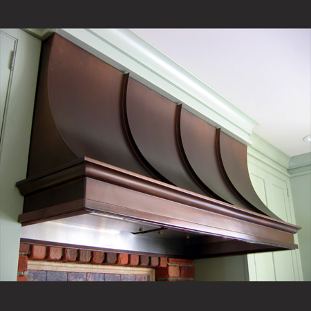 Copper Range Hood with standing seam panels and ogee moulding