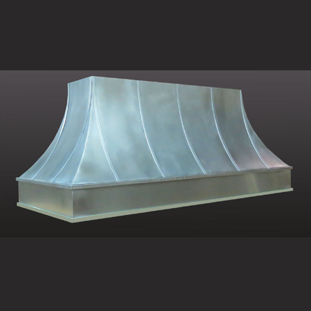 Island range hood fabricated with zinc sheet featuring four concave sides with vertical strapping details and a recessed fascia detail below.