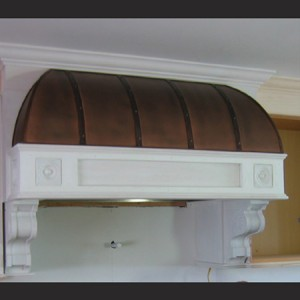"Copper Range Hood features vertical banding details with hand-set brass rivets, hip caps and a 1/4"" piping detail around the perimeter."