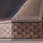 Copper Range Hood with basket weave, half-round and strapping details.